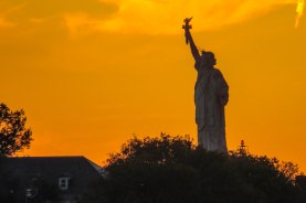 New York City - Statue of Liberty at sunset.
