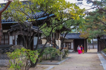 Korea - A newly wed couple strolling through the garden of the royal residence.