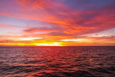 Thailand - The breathtaking sunrise over the Andaman sea while being on a diving boat. The wake up call was at 6am.