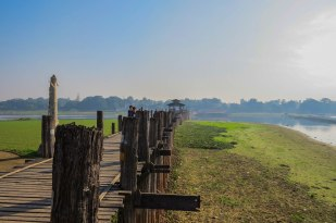 Mandalay - U Bein Bridge. The worlds longest teak bridge. During the rainy season the water is several meters higher.