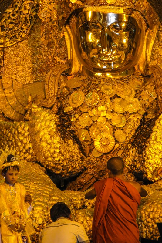 Mandalay - The Mahamuni Buddha. Said to be two thousand years old. It is covered with a 15 cm thick layer of pure gold.