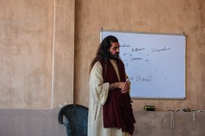 Yoga guru Omo teaching yoga theory.