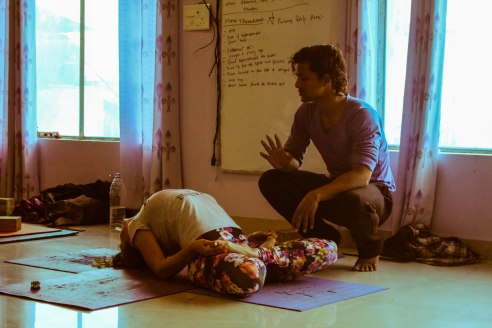 Our vinyasa teacher Vikas explaining details of a yoga pose.