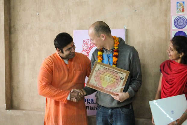 Receiving my certificate from Harsh the founder of the yoga school.